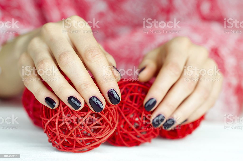 Hands with manicure touching decoration balls royalty-free stock photo
