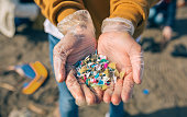 istock Hands with microplastics on the beach 1150805328