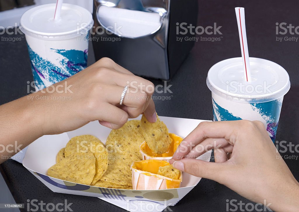Hands with Nachos I royalty-free stock photo