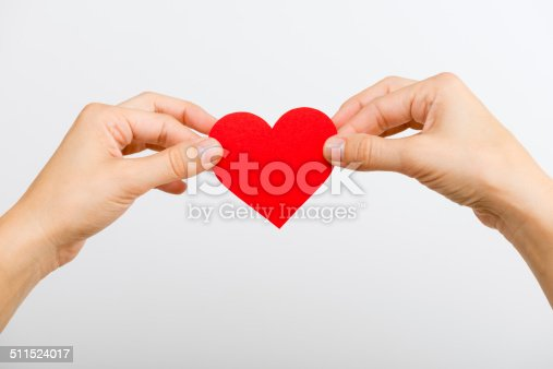 istock Hands with paper heart 511524017