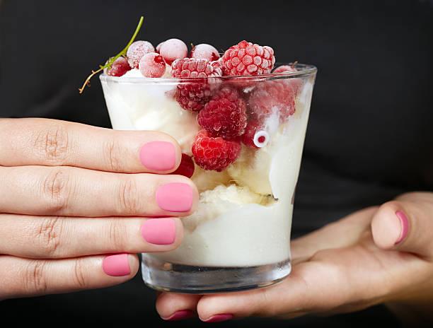 hands with pink matte manicured nails - nails ice cream imagens e fotografias de stock