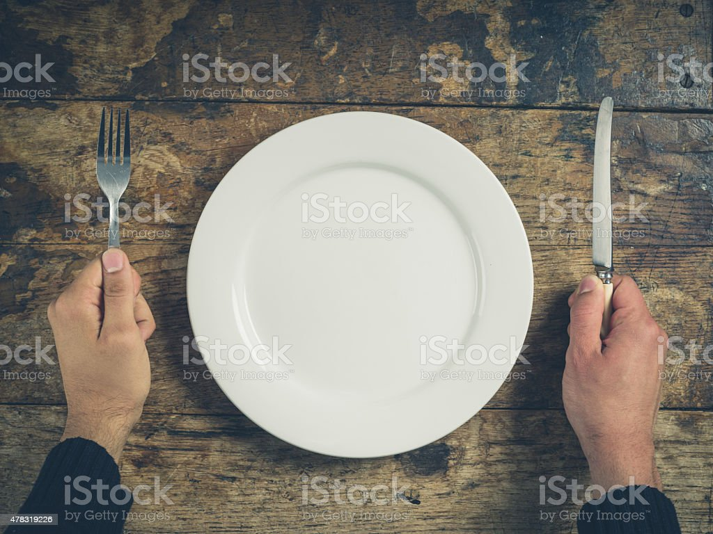 Hands with plate, knife and fork stock photo