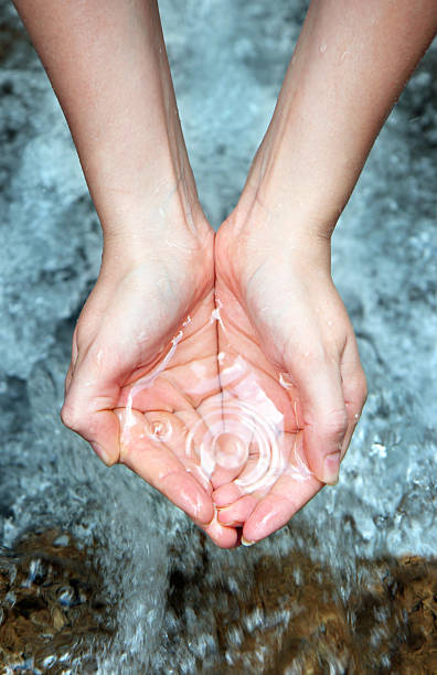 Hands with pure water woman's hands over a water cascade handful stock pictures, royalty-free photos & images