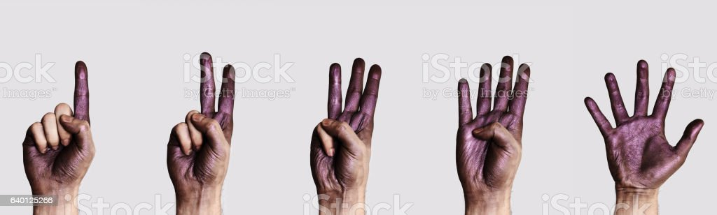 Hands with purple Paint count stock photo