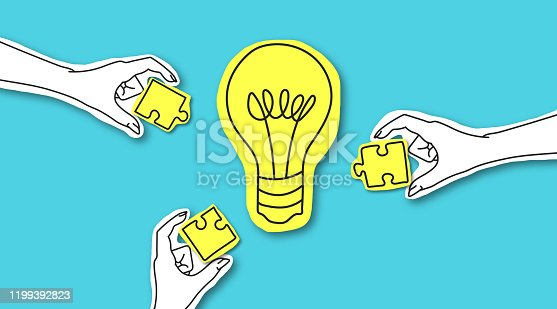 Teamwork, creative society, platform. Hands with puzze peaces around yellow light bulb over blue background