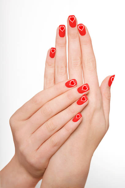 Hands With Red Nail Varnish Stock Photo