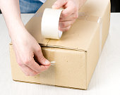 istock Hands with roll adhesive tape 1176436467
