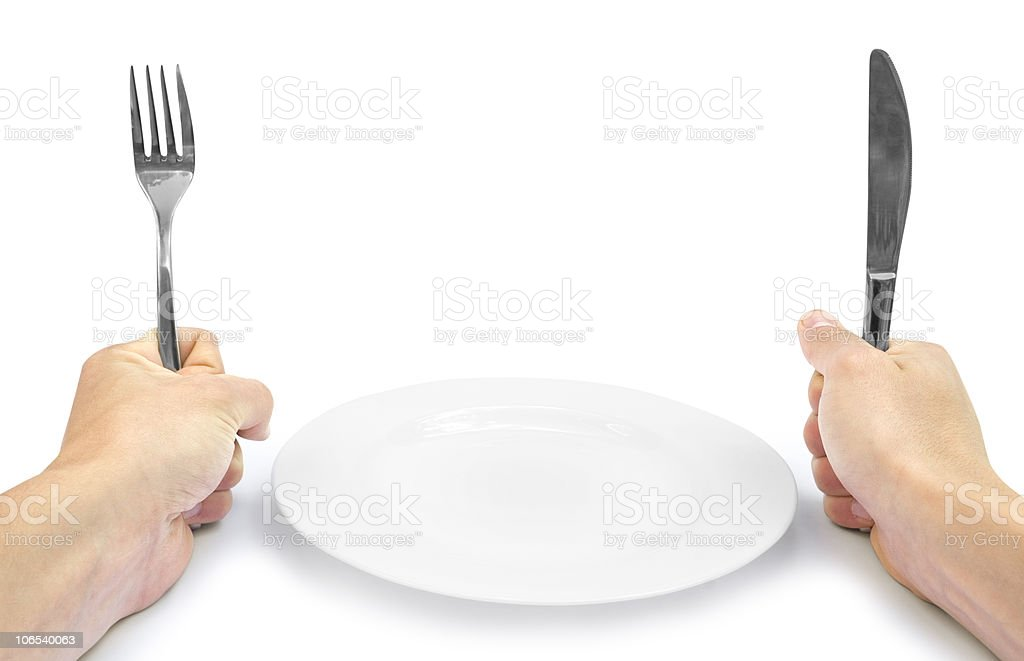 Hands with silverware stock photo