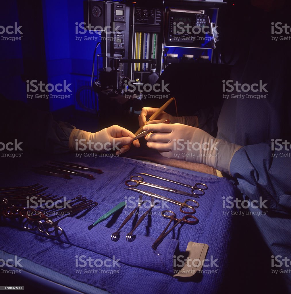 Hands with Surgical Instuments royalty-free stock photo