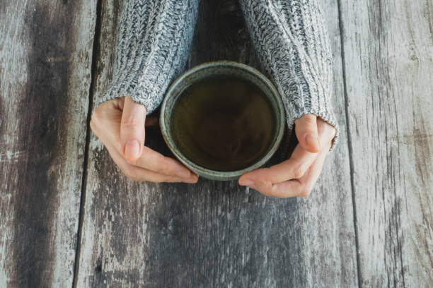 Hands with tea cup stock photo
