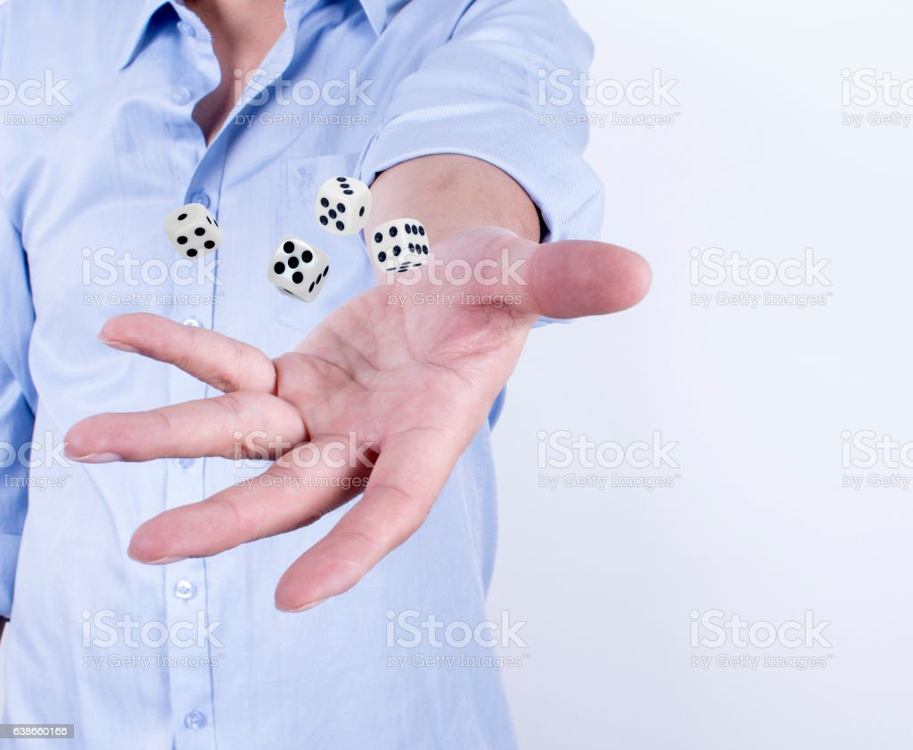 Hands with the dice. stock photo