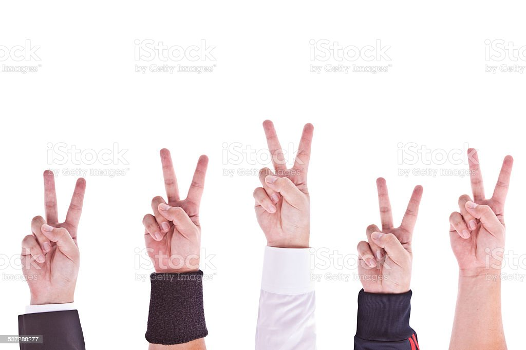 Hands with victory sign stock photo