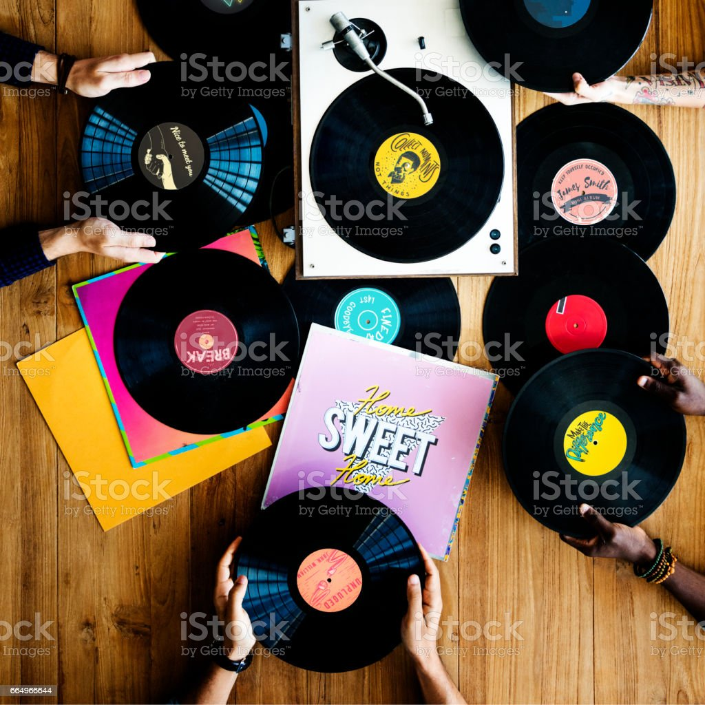Hands with Vinyl Record Player Music stock photo