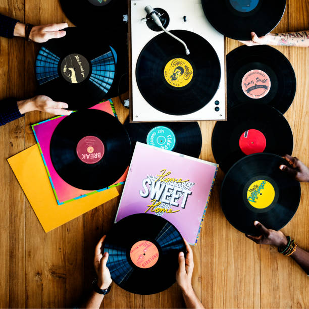 hands with vinyl record player music - records stock photos and pictures