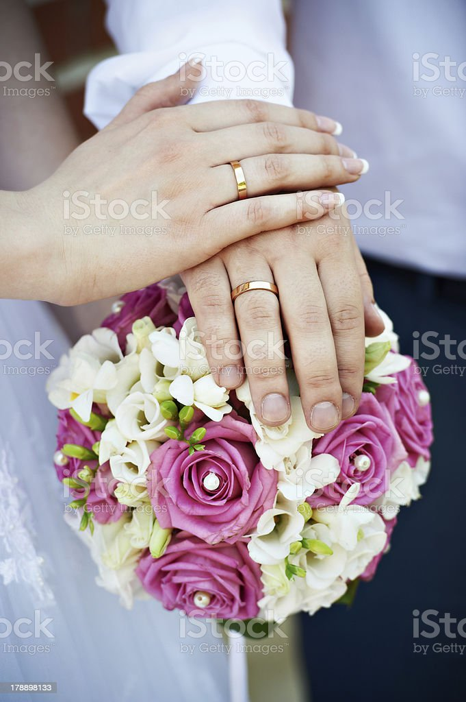 Hands with wedding gold rings royalty-free stock photo