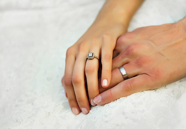 hands with wedding rings - diamond ring hand stock photos and pictures
