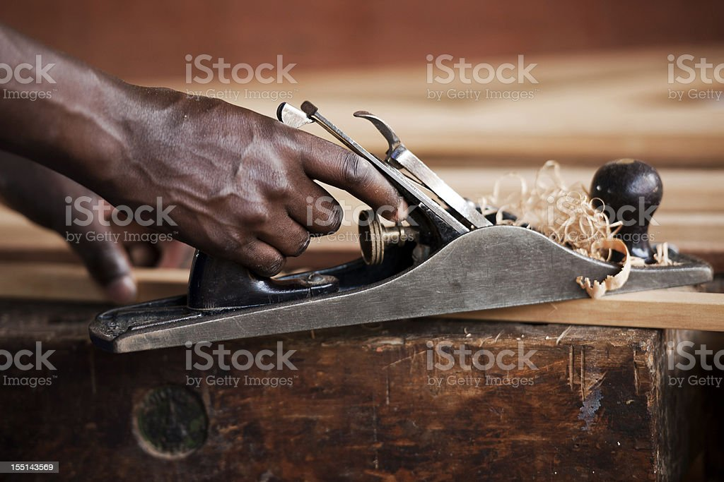 Hands with wood planer stock photo