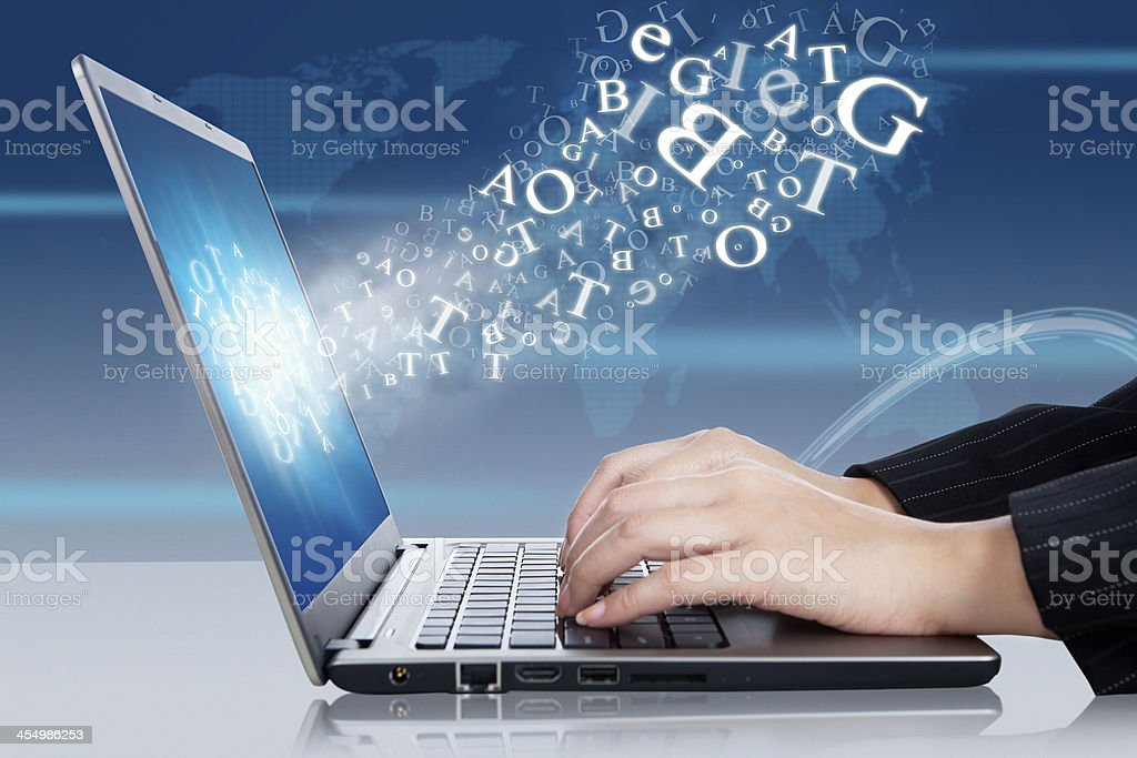Hands working on a laptop representing online business stock photo