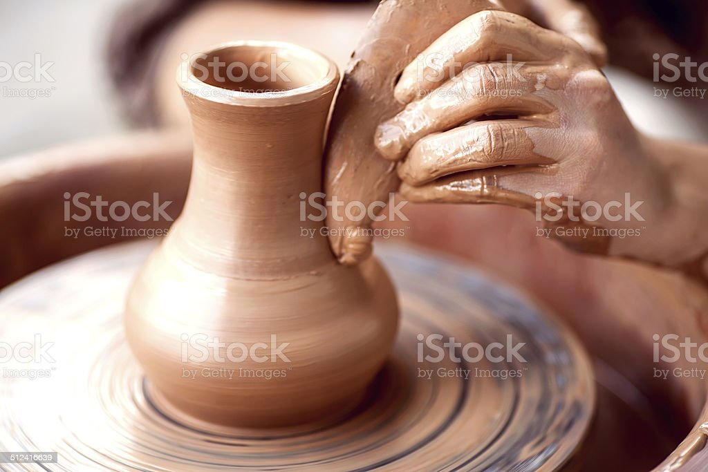 Hands working on pottery wheel stock photo