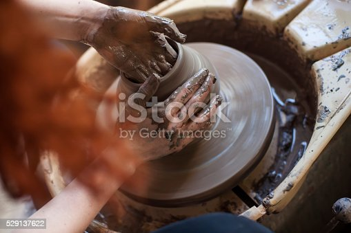 istock Hands working on pottery wheel 529137622
