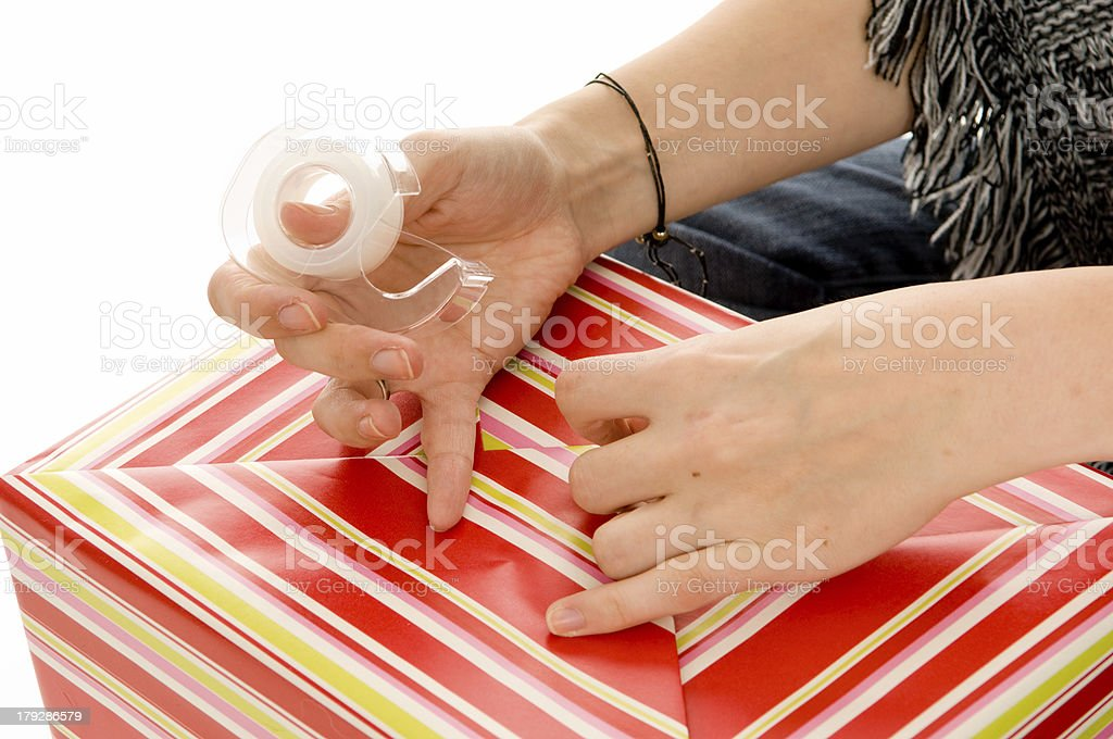 Hands Wrapping Present (Close-up) royalty-free stock photo