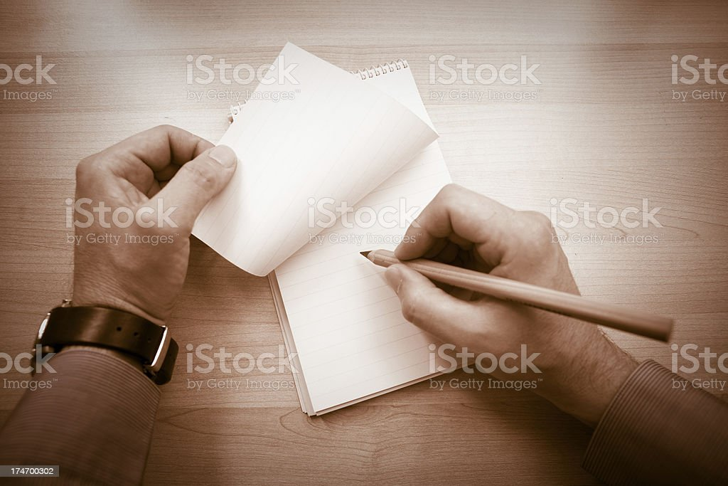 Hands writing a note royalty-free stock photo