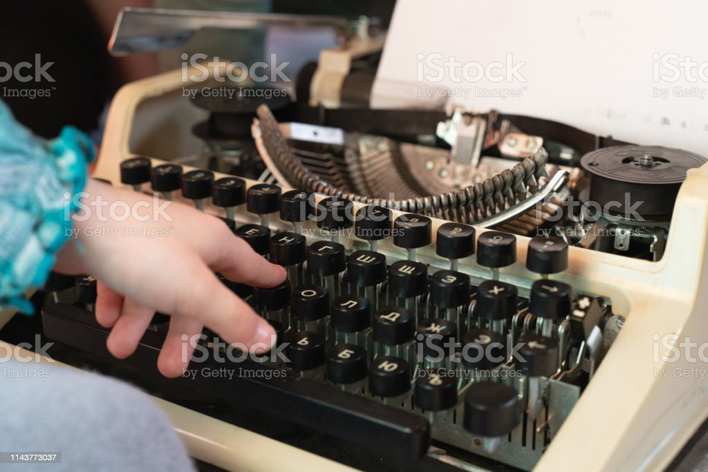 Hands Writing On An Old Typewriter Retrostyle Keyboard And