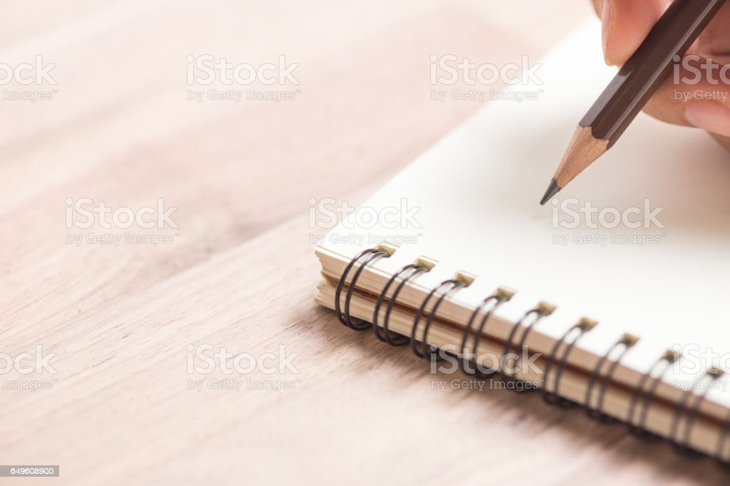 Hands writing on notebook stock photo