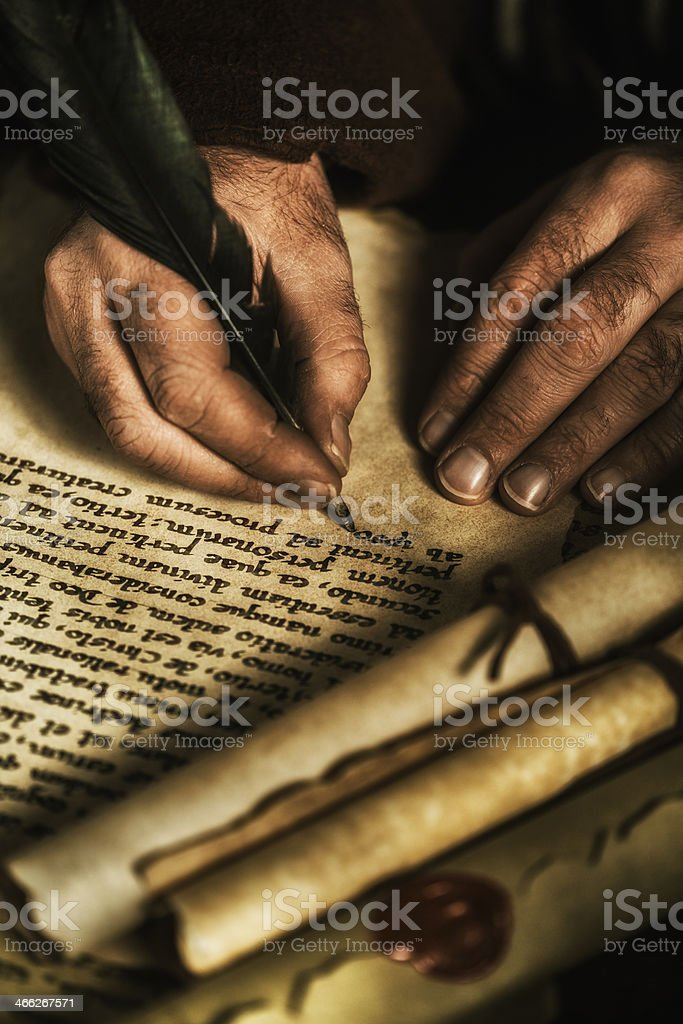 Hands writing on parchment stock photo