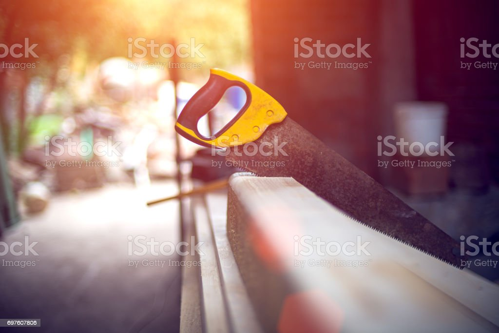 Handsaw in the white wood stock photo