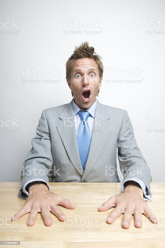 Hands-Down Surprise Businessman Sitting at Desk Wide Eyes royalty-free stock photo
