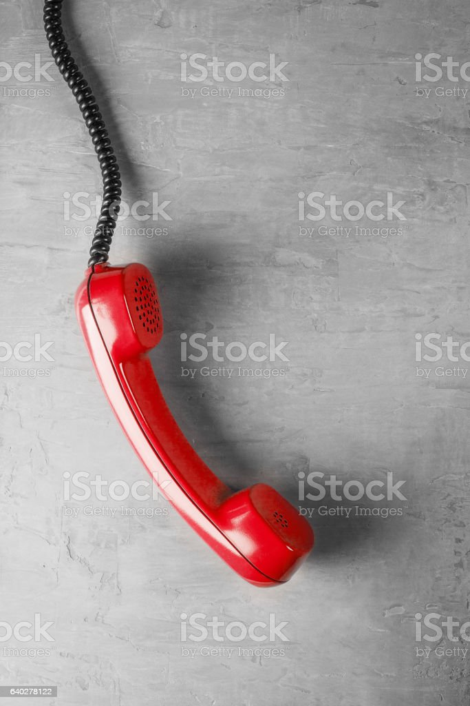 handset from landline phone on the background wall stock photo