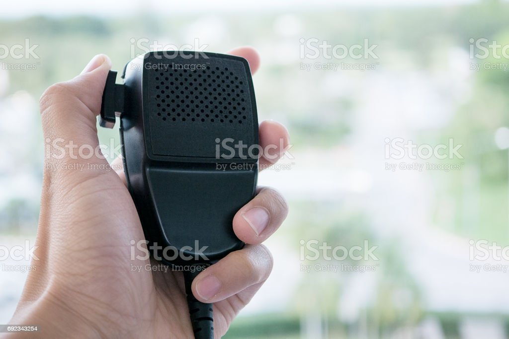 Handset of portable radio holding in hand stock photo