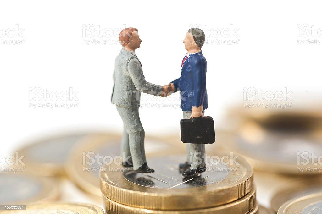 Handshake abstract figurine stock photo