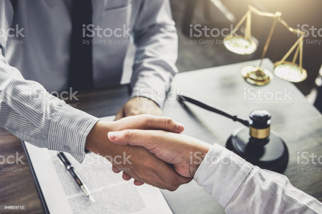 Handshake after good cooperation, Businessman handshake male lawyer after discussing good deal of Trading contract and new projects for the company of real estate, Meeting and greeting concept stock photo