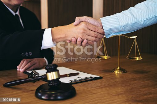 istock Handshake after good cooperation, Consultation between a male lawyer and businessman customer, tax and the company of real estate concept 910154916
