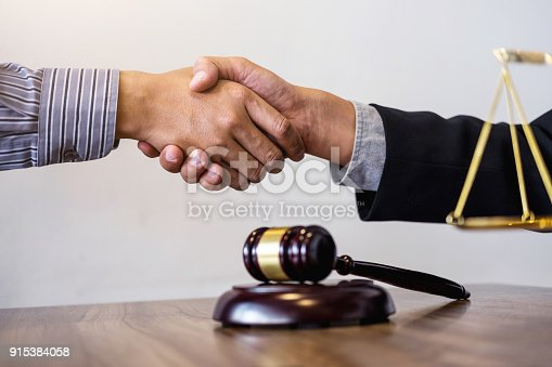 istock Handshake after good cooperation, Consultation between a male lawyer and businessman customer, tax and the company of real estate concept 915384058