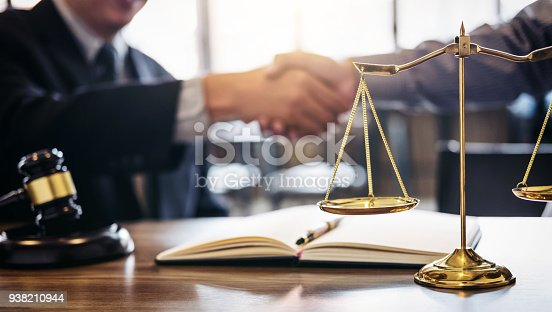 istock Handshake after good cooperation, Consultation between a male lawyer and businessman customer, tax and the company of real estate concept 938210944