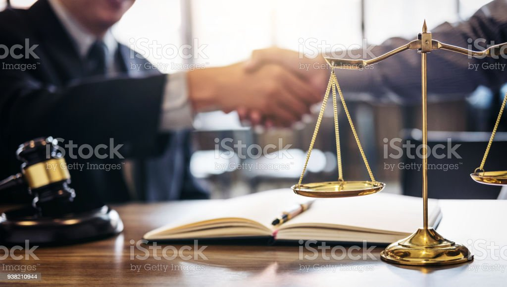 Handshake after good cooperation, Consultation between a male lawyer and businessman customer, tax and the company of real estate concept stock photo