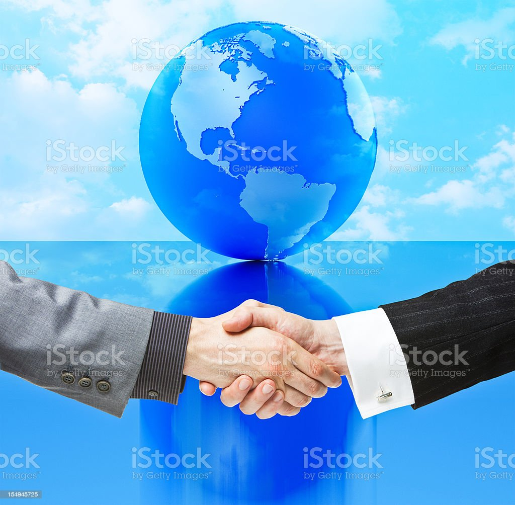 Handshake against Globe - North and South America royalty-free stock photo