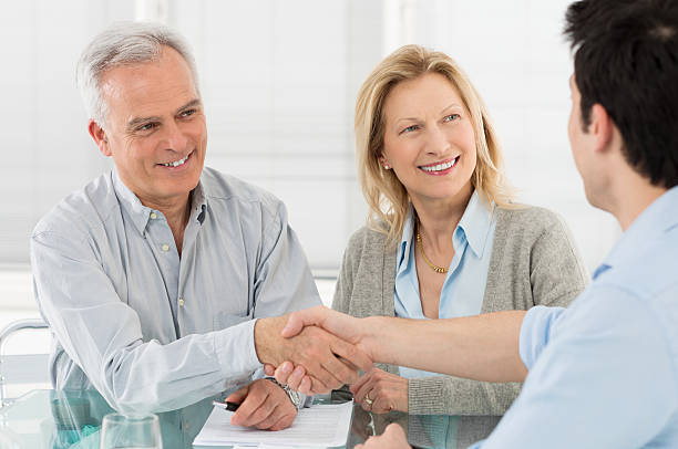 handshake and agreement - bankers stock photos and pictures