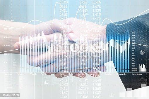 istock handshake and business statistics, double exposure 494423578