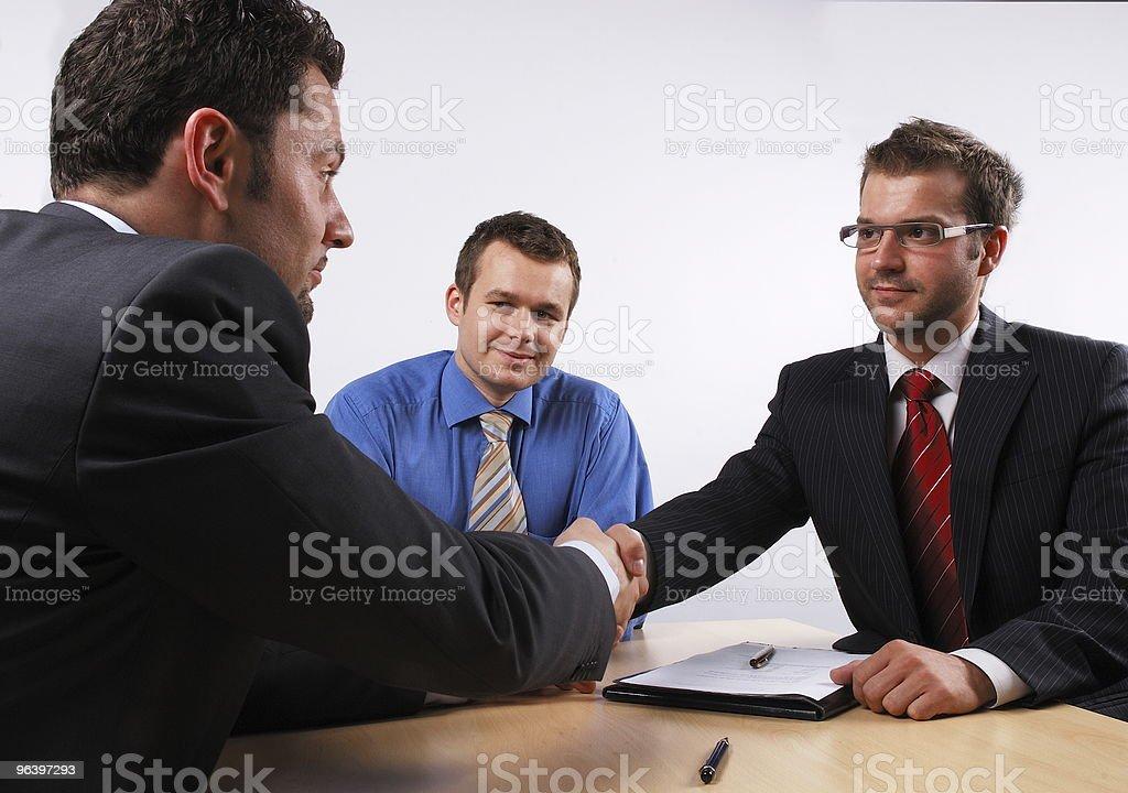 handshake at the  business meeting stock photo