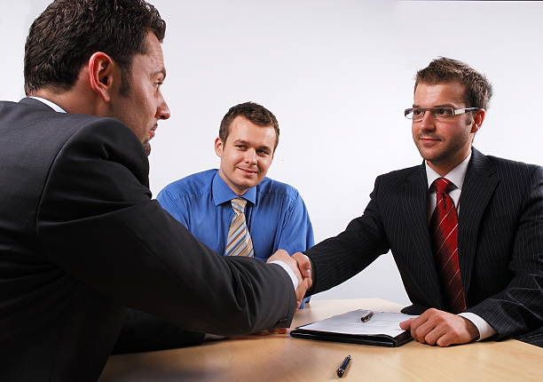 handshake at the  business meeting stock photo