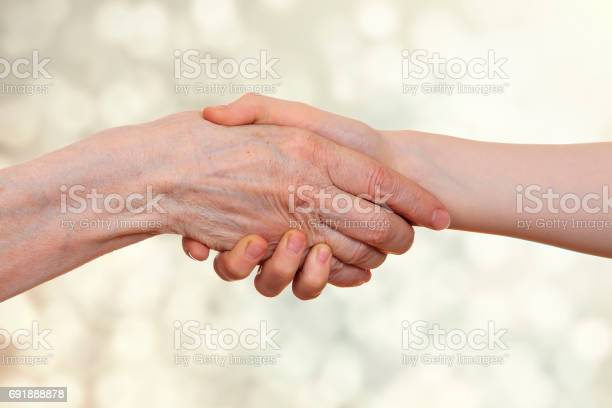 Handshake between an old person with a wrinkled hand and a kid picture id691888878?b=1&k=6&m=691888878&s=612x612&h= 5li pydv2klvi2bqbisycvkalybkozcjmgsmfeqh6a=