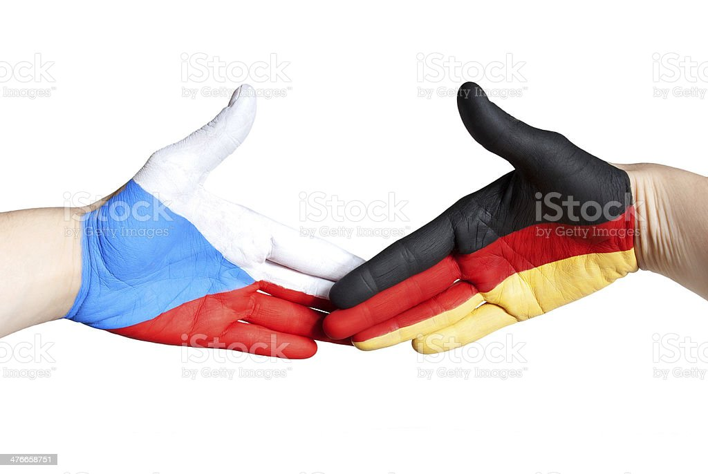 handshake between germany and czech republic royalty-free stock photo