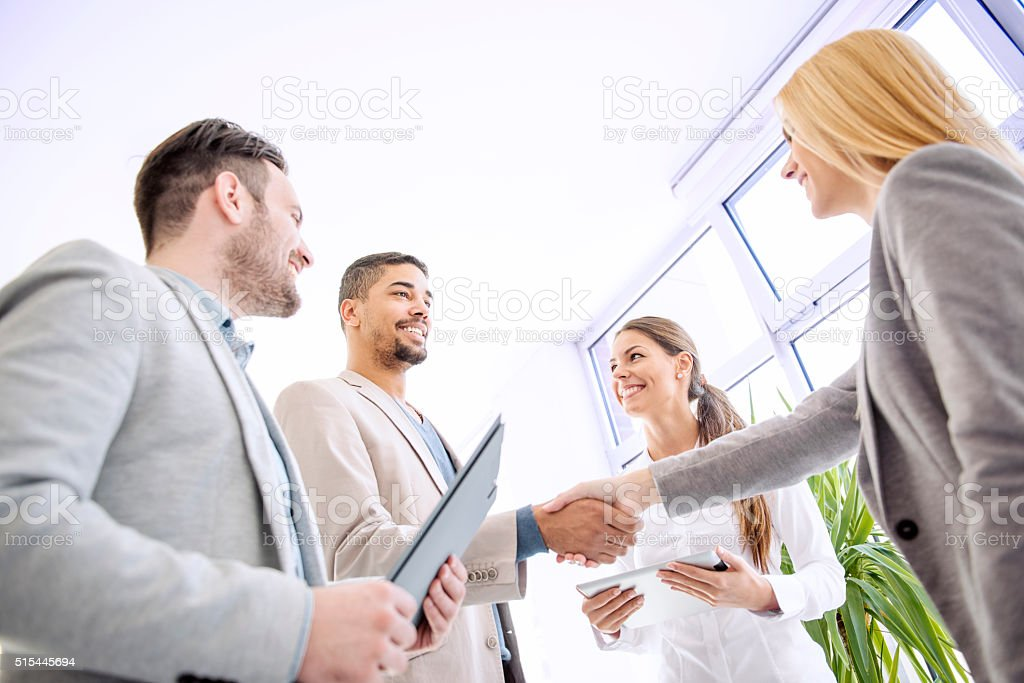 Handshake between two business executives stock photo