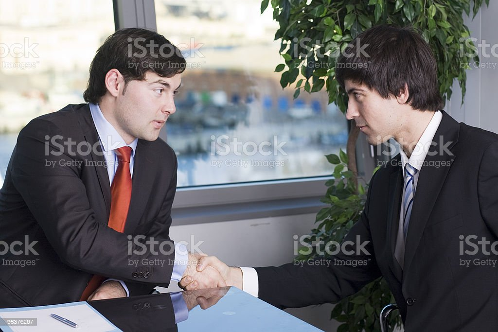 Handshake between two businessmen royalty-free stock photo