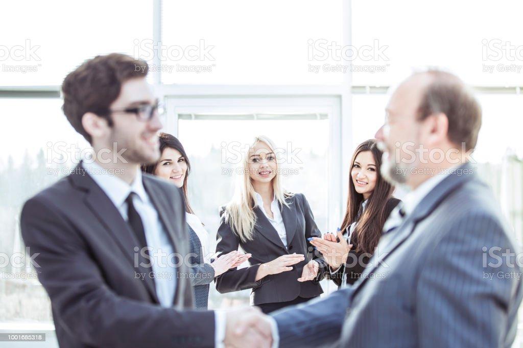 closeup of a business handshake partners before beginning business...