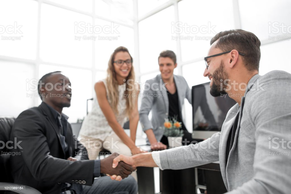 handshake business people in the office stock photo